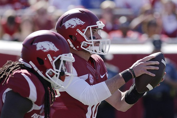 Arkansas quarterback Brandon Allen, right, takes a snap in the first half of an NCAA college football game against Toledo in Little Rock, Ark., Saturday, Sept. 12, 2015. (AP Photo/Danny Johnston)