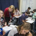 Christine Morledge helps students in her physics class Monday at Har-Ber High School in Springdale. ...