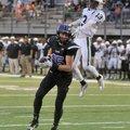 Drake Wymer, Fayetteville receiver, scores a touchdown in front of Muskogee, Okla., defender Tavian ...