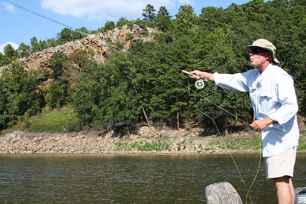 Rusty pruitt casts a fly to schooling crappie tuesday in for Lake bryan fishing