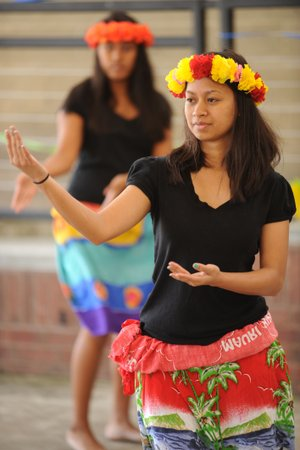 Lillian Chonggum of Springdale dances a traditional Marshallese dance Saturday, during Welcoming NWA: Celebrating the Cultural Diversity of Northwest Arkansas in Springdale.
