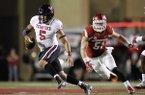 Arkansas linebacker Brooks Ellis (51) chases Texas Tech quarterback Patrick Mahomes II during the second half of an NCAA college football game, Saturday, Sept. 19, 2015, in Fayetteville, Ark. Texas Tech beat Arkansas 35-24. (AP Photo/Samantha Baker)