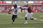 Texas Tech receiver Quan Shorts slips past Arkansas defender DJ Dean to score a touchdown in the first quarter of their game Saturday, Sept. 19, 2015, at Razorback Stadium in Fayetteville.