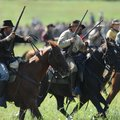 Members of the Confederate cavalry ride into battle Saturday during a re-enactment of the Civil War ...