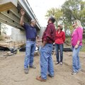 Shawn Shrum (left), assistant road superintendent with Washington County, leads a tour Monday undern...
