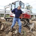 Shawn Shrum, assistant road superintendent with Washington County, walks down underneath the Harvey...