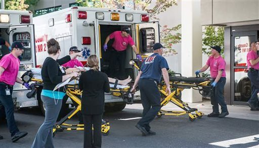 a-patient-is-wheeled-into-the-emergency-room-at-mercy-medical-center-in-roseburg-ore-after-a-deadly-shooting-at-umpqua-community-college-in-roseburg-on-thursday-oct-1-2015