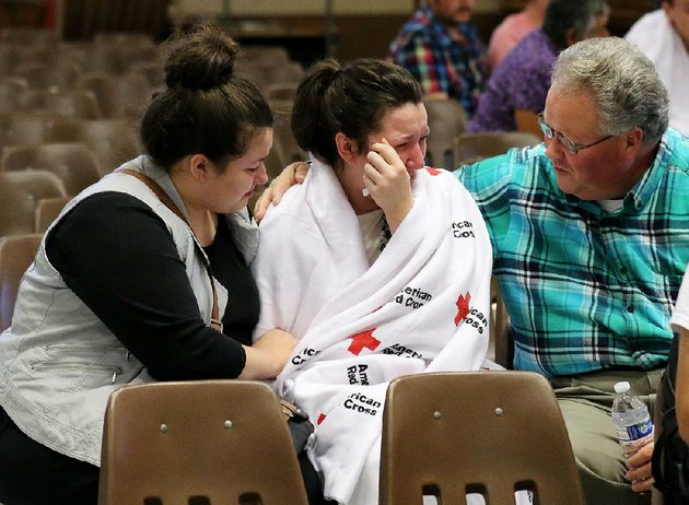 hannah-miles-center-is-comforted-by-her-sister-hailey-and-her-father-gary-after-a-shooting-thursday-at-umpqua-community-college-in-roseburg-ore