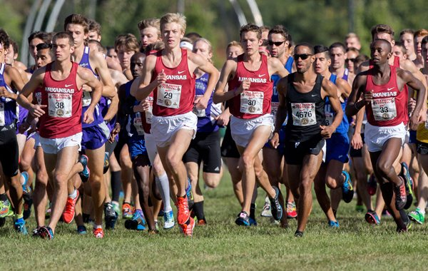 Arkansas runners begin the collegiate 8K on Saturday, Oct. 4, 2014, during the 26th annual Chile Pepper Cross Country Festival at Agri Park in Fayetteville.