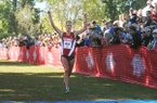 Arkansas cross country runner Dominique Scott crosses the finish line to take first in the College Women's 5000m at the 2015 Chile Pepper Cross Country Festival Saturday, Oct. 3, 2015, in Fayetteville.