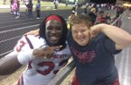 Hope's McTelvin Agim and Razorback fan Canaan Sandy celebrate after the Bobcat's victory.