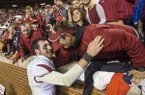 Arkansas quarterback Brandon Allen celebrates with fans following a game against Tennessee on Saturday, Oct. 3, 2015, at Neyland Stadium in Knoxville, Tenn.
