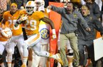 Tennessee head coach Butch Jones cheers on Evan Berry (29) as he returns a kickoff for a touchdown during the first half of an NCCAA College football game against Arkansas Saturday Oct. 3, 2015, in Knoxville, Tenn. (Larry McComack /The Tennessean via AP)