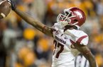 Arkansas receiver Dominique Reed celebrates after scoring a touchdown during the second quarter of a game against Tennessee on Saturday, Oct. 3, 2015, at Neyland Stadium in Knoxville, Tenn.