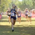 Elise Reina, Springdale Har-Ber cross country runner, crosses the finish line as she competes in the...