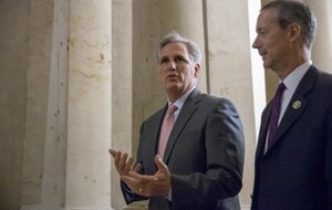 In this Sept. 30, 2015 file photo, House Majority Leader Kevin McCarthy of Calif., left, walks  on Capitol Hill in Washington.