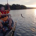 Mike McBride catches a crappie at sunrise Sept. 24 at Lake Sequoyah. He caught several using a jig u...