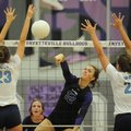 Faith Waitsman (12) of Fayetteville hits past Emily Thompson (23) and Paige Williams (21) of Springd...