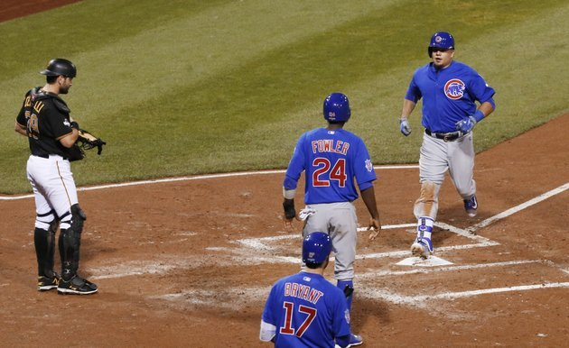 chicago-cubs-kyle-schwarber-right-steps-on-home-plate-after-he-drove-dexter-fowler-24-in-with-a-two-run-home-run-in-the-third-inning-of-the-national-league-wild-card-baseball-game-against-the-pittsburgh-pirates-wednesday-oct-7-2015-in-pittsburgh-pittsburgh-pirates-catcher-francisco-cervelli-is-at-left-ap-photogene-j-puskar