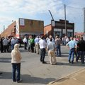 A large crowd gathers Thursday to listen to an announcement Tyson Foods plans an office building for...