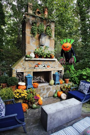 "A touch of Halloween livens up the fall decor in the yard of Little Rock-based home and garden expert Chris H. Olsen. ""I do it for the kid in me,"" he says. ""And then I share it with the people in the neighborhood, because it's more fun."""