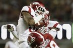 Arkansas defensive back Josh Liddell (28) intercepts the ball intended for Alabama tight end O.J. Howard (88) in the first half of an NCAA college football game, Saturday, Oct. 10, 2015, in Tuscaloosa, Ala. (AP Photo/Brynn Anderson)