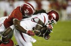 Alabama linebacker Rashaan Evans (32) tackles Arkansas running back Alex Collins (3)in the second half of an NCAA college football game, Saturday, Oct. 10, 2015, in Tuscaloosa, Ala. (AP Photo/Brynn Anderson)