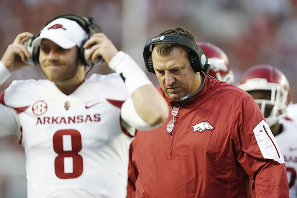 Arkansas head coach Bret Bielema walks the sideline with Arkansas quarterback Austin Allen (8) in the first half of an NCAA college football game, Saturday, Oct. 10, 2015, in Tuscaloosa, Ala. (AP Photo/Brynn Anderson)