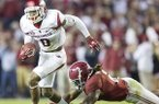 Arkansas defensive back Santos Ramirez (9) slips away from Alabama running back Derrick Henry (2) after intercepting a pass in the second quarter on Saturday, Oct. 10, 2015, at Bryant-Denny Stadium in Tuscaloosa, Ala.