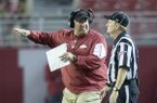 Arkansas head coach Bret Bielema pleads his case to an official following a penalty on a blocked punt during the third quarter against Alabama on Saturday, Oct. 10, 2015, at Bryant-Denny Stadium in Tuscaloosa, Ala.