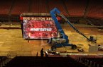 Workers work to install a new video board on Wednesday, Oct. 14, 2015, at Bud Walton Arena in Fayetteville.