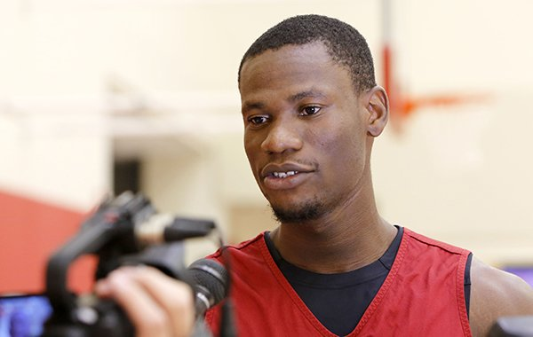 Arkansas center Moses Kingsley speaks to reporters on Monday, Oct. 5, 2015, at the Razorbacks' basketball practice facility in Fayetteville.
