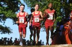 From left: Arkansas runners Alex George, Frankline Tonui and Christian Heymsfield compete during the Chile Pepper Cross Country Festival on Saturday, Oct. 3, 2015, in Fayetteville.