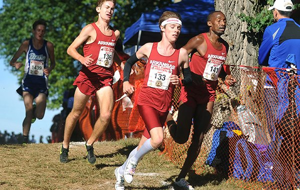 Arkansas' Alex George (133) runs ahead of Frankline Tonui (141) and Christian Heymsfield (136) during the Chile Pepper Cross Country Festival on Saturday, Oct. 3, 2015, in Fayetteville.