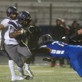Javontae Smith, Fayetteville running back, avoids a tackle by Rogers High defensive tackle Luis Sala...