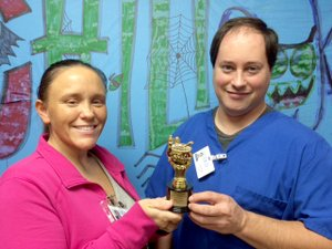 "Photo by Amanda Gittlein Leslie South and Clayton Sandridge show off the trophy they were awarded as winners of the best chili in chili cook-off competition at Ozarks Community Hospital Saturday evening. Their ""After Burn Team"" also won a $100 cash prize. Leslie and Clayton work in the dietary department at the hospital."