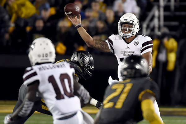 Mississippi State quarterback Dak Prescott throws during the first half of  an NCAA college football game a04638394