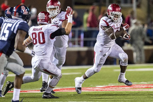Arkansas running back Alex Collins carries the ball on a fourth-down play on Saturday, Nov. 7, 2015, during overtime against Ole Miss at Vaught-Hemingway Stadium in Oxford, Miss.