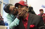 Arkansas Democrat-Gazette/MELISSA SUE GERRITS - 11/12/15 - Janice Birt kisses her nephew Daryl Macon after he signed with the Arkansas Razorbacks' Basketball team November 12, 2015 at the Little Rock Chamber of Commerce. Macon was joined by his mom Deloise, sisters Tiffany and Tierra as well as extended family members, coaches and friends to celebrate his signing.