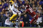 LSU quarterback Brandon Harris (6) scrambles to avoid Arkansas linebacker Dre Greenlaw (23) in the first half of an NCAA college football game in Baton Rouge, La., Saturday, Nov. 14, 2015. Harris fumbled on the play setting up an Arkansas touchdown. (AP Photo/Gerald Herbert)