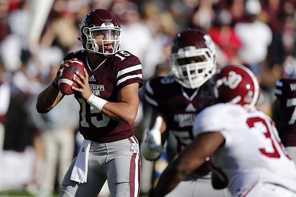 Mississippi State quarterback Dak Prescott (15) looks for an open receiver as he is pressured by Alabama linebacker Denzel Devall (30) during the first half of an NCAA college football game in Starkville, Miss., Saturday, Nov. 14, 2015. (AP Photo/Rogelio V. Solis)
