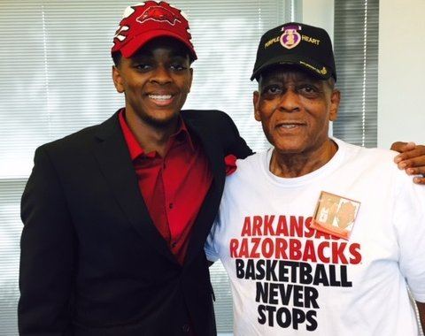 Daryl Macon and his grandfather, Robert Lee Harrison pose after his signing with the Hogs.