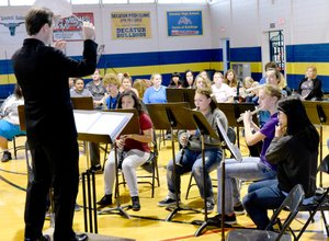 Photo by Mike Eckels Jesse Owens, Decatur's band and choir director, conducts the Decatur High School band in a medley of familiar John Phillip Sousa marches, including Stars and Strips Forever, during the Decatur High School Veterans Day assembly at Peterson Gym on Nov. 11.