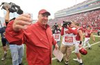 NWA Democrat-Gazette/MICHAEL WOODS • @NWAMICHAELW University of Arkansas players coach Bret Bielema celebrates with his team after the Arkansas Razorbacks 54-46 win in 4 overtimes over Auburn after Saturdays game at Razorback Stadium in Fayetteville.
