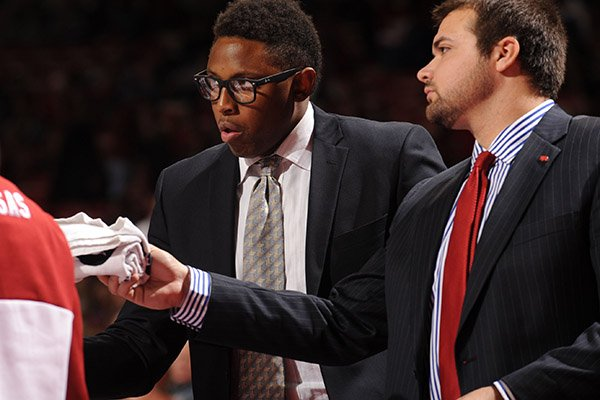 Marcus Monk, pictured here as an Arkansas basketball graduate assistant in 2013, has come under fire this week because of his role in his brother committing to Kentucky.