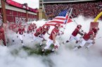 Arkansas players run on to the field prior to a game against Auburn on Saturday, Oct. 24, 2015, at Razorback Stadium in Fayetteville.