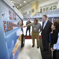 Ed Clifford (from right), president/CEO of The Jones Trust, looks at The Jones Center's new Zamboni ...
