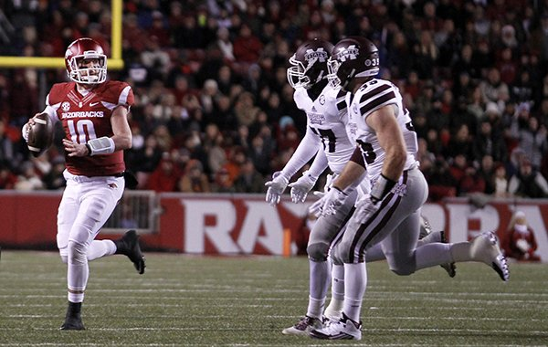 Arkansas' Brandon Allen (10) makes a pass attempt while on the run during the first half of an NCAA college football game against Mississippi State, Saturday, Nov. 21, 2015 in Fayetteville, Ark. Mississippi State beat Arkansas, 51-50. (AP Photo/Samantha Baker)