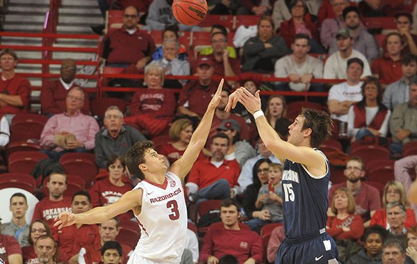 Akron's Jake Ketzer shoots over Arkansas' Dusty Hannahs during a game Wednesday, Nov. 18, 2015, at Bud Walton Arena in Fayetteville.