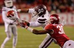 Mississippi State receiver Fred Ross catches a pass in front of Arkansas safety Kevin Richardson on Saturday, Nov. 21, 2015, at Razorback Stadium in Fayetteville.